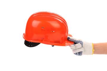 Man holding red helmet over white