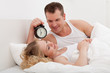 couple lying in bedroom