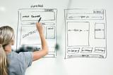 designer drawing website development wireframe