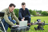 Technicians Using Laptop By UAV Drone