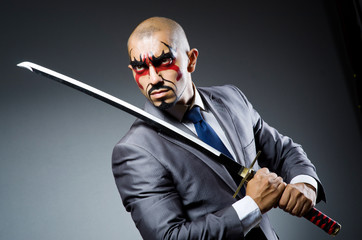 Man with face paint and sword