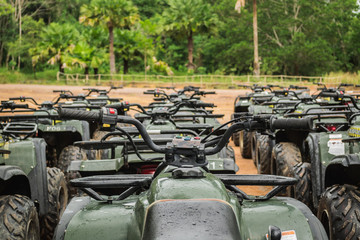 sports quad bike or atv arranged in row