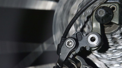 Rear derailleur on a mountain bike in motion close-up