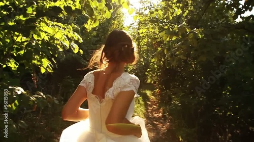 Woman In Vintage Wedding Dress Runnning Slow Motion Forest