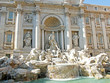 fontana di trevi in Rome with white marble statues