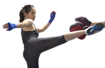 Woman practicing Thai boxing technique.(Muay Thai)
