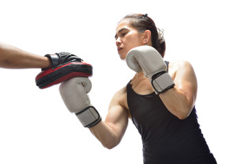Woman hitting boxing pad.