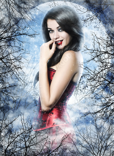 Beautiful young woman as sexy vampire Poster