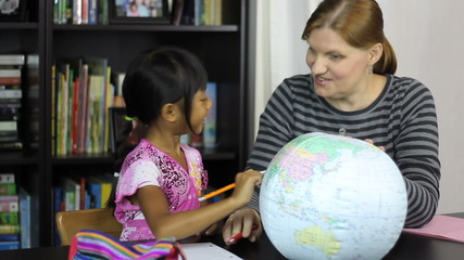Homeschool Mom Teaching Asian Daughter Geography Lesson