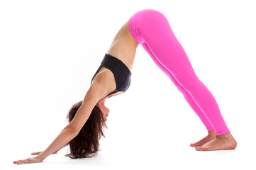 Pretty Woman in Yoga Pose - Downward Facing Dog Position.
