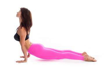 Pretty Woman in Yoga Pose - Upward Facing Dog Position.