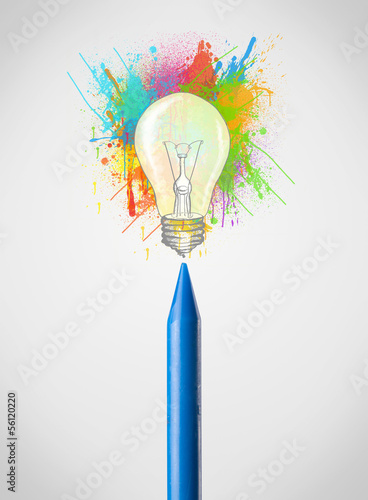 Crayon close-up with colored paint splashes and lightbulb