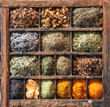 Variety of Indian spices in a wooden box