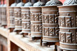 Prayer wheels in Rudra Varna Mahavihar temple in Patan. Nepal.