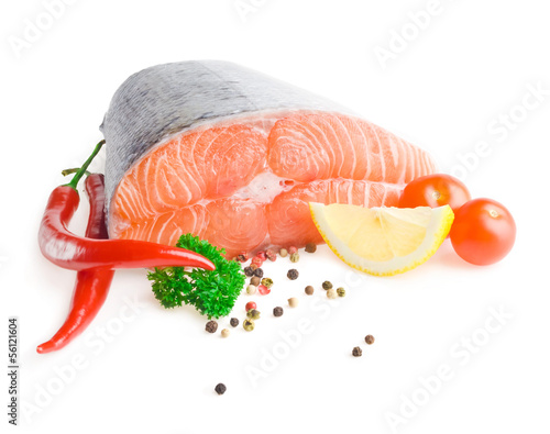 Salmon steak with lemon, pepper and parsley