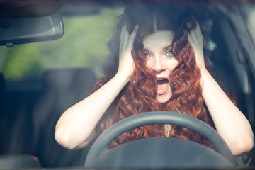 Woman sitting in car