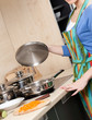 Attractive woman in striped apron cooks