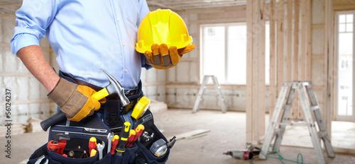 Leinwanddruck Bild Handyman with a tool belt.