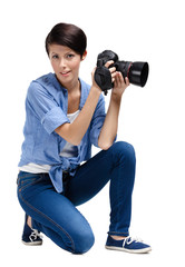 Lady-photographer takes snapshots, isolated on white