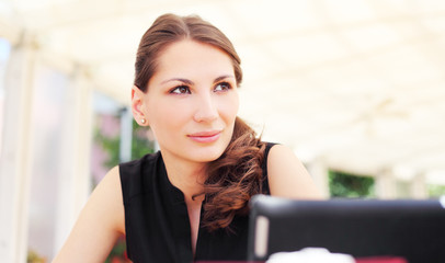 Image of pretty young woman in cafe
