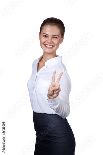 Brunette shows a symbol of victory