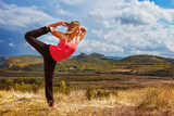 Yoga practice on mountain hills