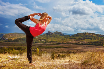 Yoga practice on mountain hills