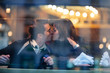 Couple in love kissing in cafe window