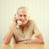 Senior woman answering phone