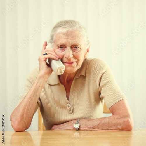 Senior woman answering phone