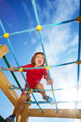 Scream fun expression of boy on playground