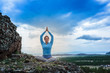 Woman practice yoga meditation on top of mountain