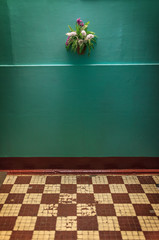 Retro interior with green wall background and checkered floor.