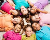 Fototapety Group of eight happy kids in star shape
