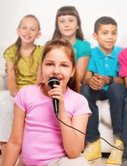 Close portrait of girl singing