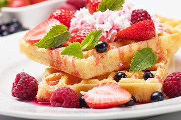 Waffle with fruit and whipped cream