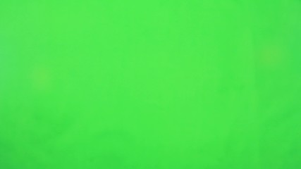 A female in a shirt making touch screen gestures in green screen