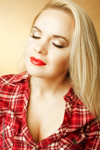 Portrait of beautiful housewife (girl next door) with long hair