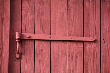 Old red painted hinge