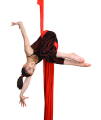 gymnastic girl exercising on red fabric rope