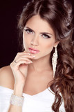 Beautiful Brunette Woman. Hairstyle. Makeup. Manicured nails. Fa