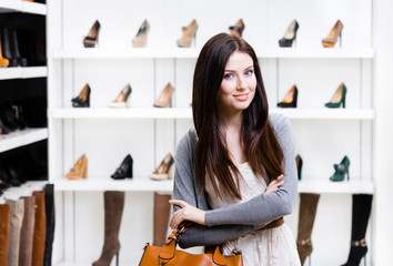 Woman in shopping center in the section of female pumps