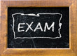 Exam handwritten with white chalk on a blackboard