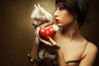 Fashionable model holding red heart & chinese crested dog