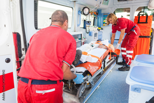 Rescue Team Providing First Aid - 56130842