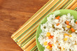 Risotto on color plate on wooden background