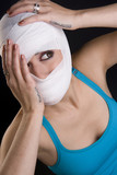Female Holds Face First Aid Gauze Wrapped Head Injury Pain poster