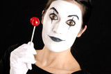 Beautiful Brunette Woman Mime Holds Lollipop Candy White Face