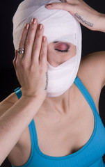 Female Holds Face First Aid Gauze Wrapped Head Injury Pain