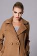 cloaeup portrait of a beautiful woman wearing coat